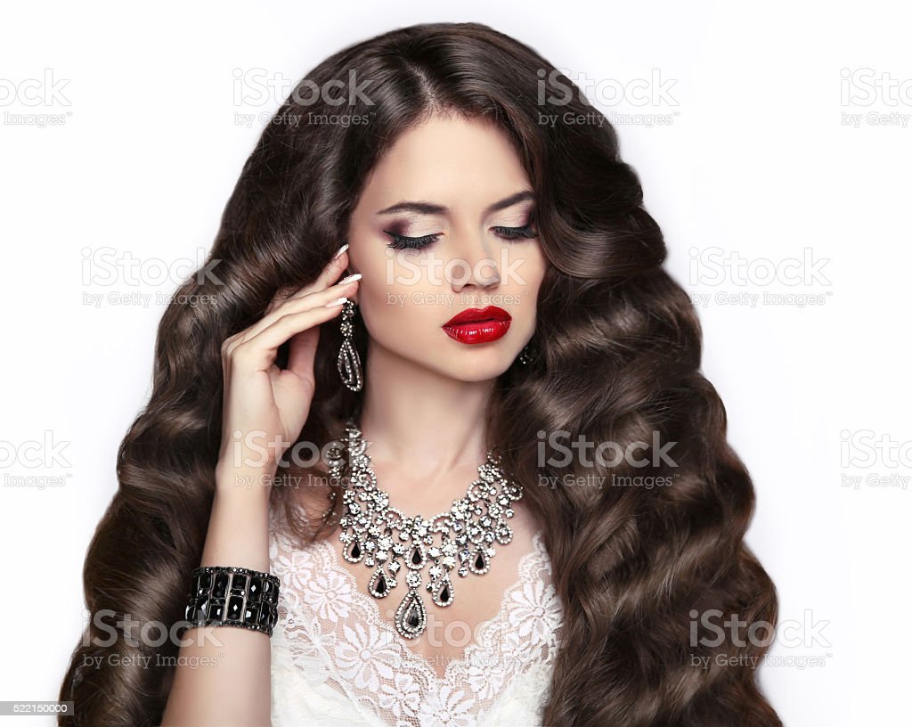 Healthy hair. Makeup. Beautiful brunette girl with long wavy hair stock photo