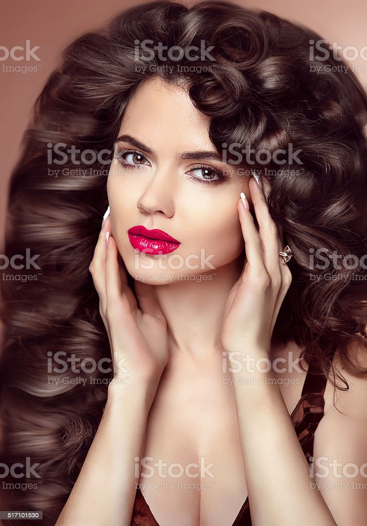 Healthy hair. Makeup. Beautiful brunette girl with long wavy stock photo