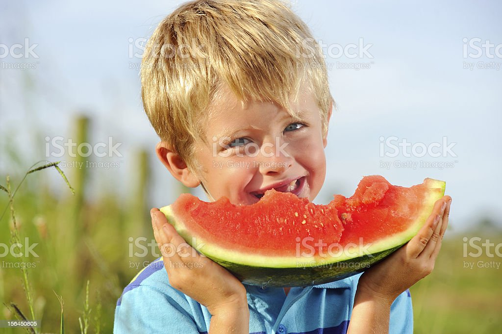 Healthy happy boy with fresh fruit royalty-free stock photo