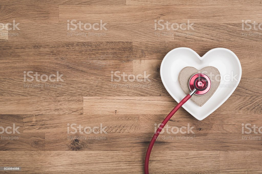 healthy heart concept on wooden background stock photo