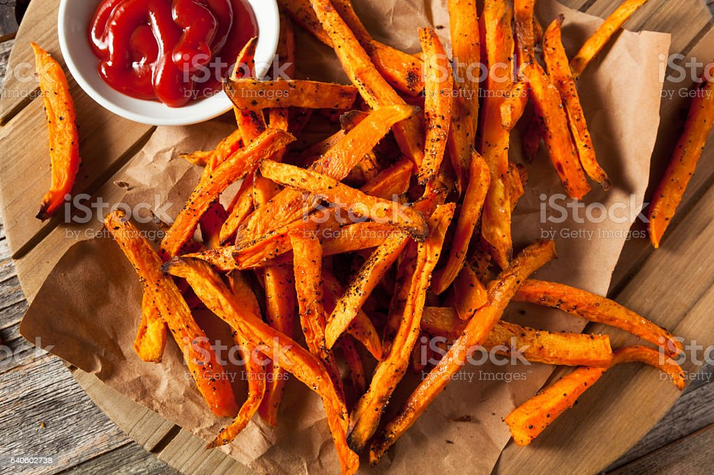 Healthy Homemade Baked Sweet Potato Fries stock photo