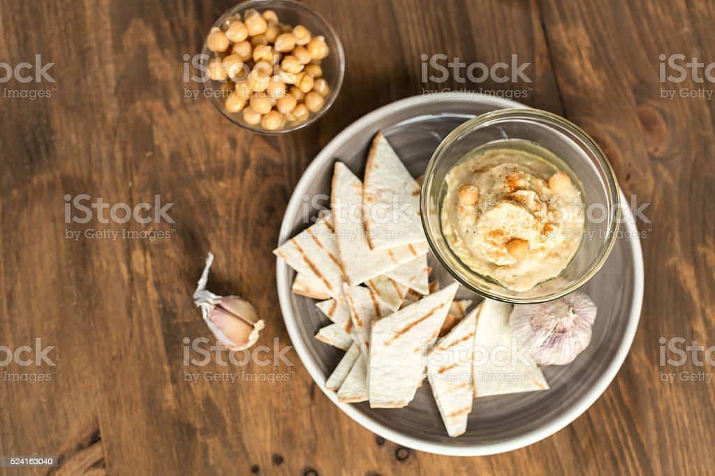 Healthy Homemade Creamy Hummus with Olive Oil and  Chips stock photo