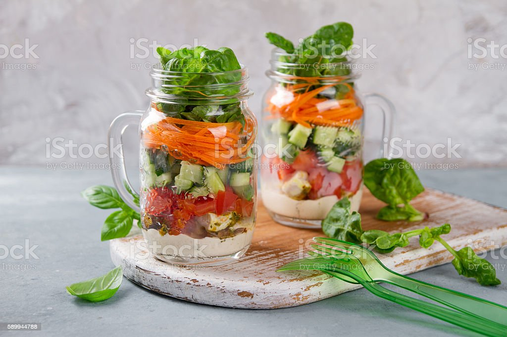 Healthy homemade mason jar salad with chicken and vegetables stock photo
