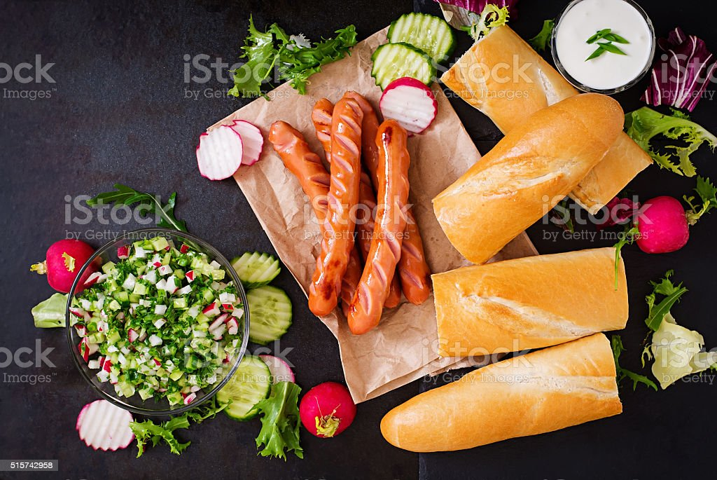 Healthy Hot Dog dressed with yogurt and cucumber salsa stock photo