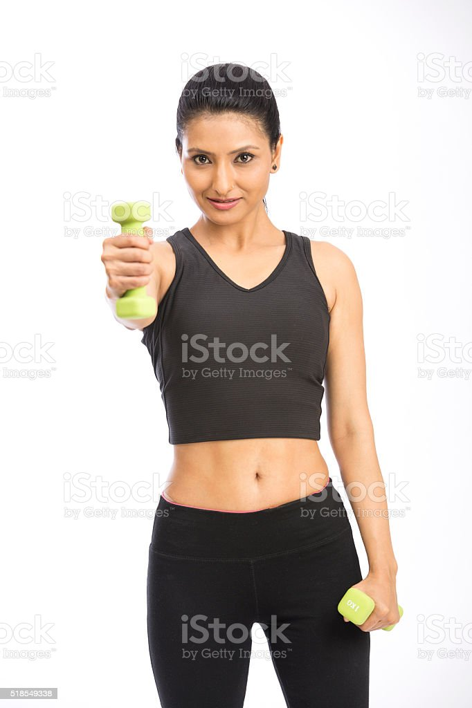 Healthy Indian woman with dumbbells stock photo