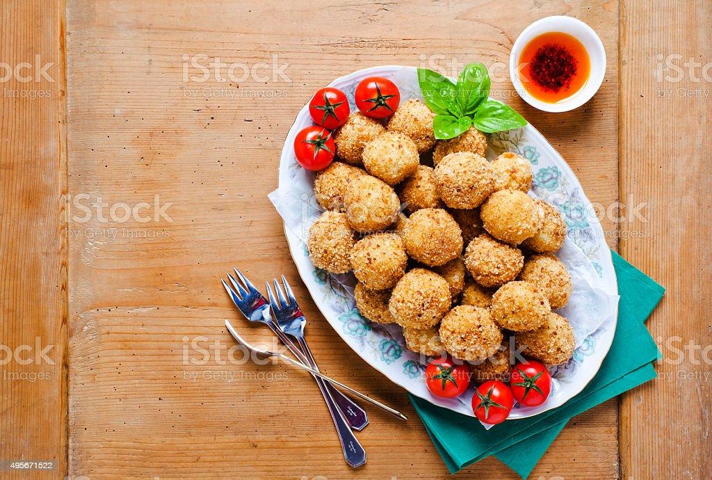 healthy italian appetizer with risotto balls arancini , green ol stock photo