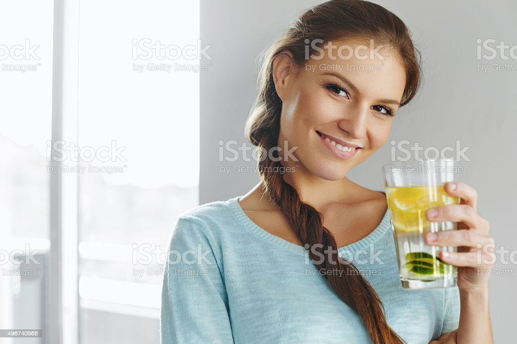 Healthy Lifestyle And Food. Woman Drinking Fruit Water. Detox. stock photo