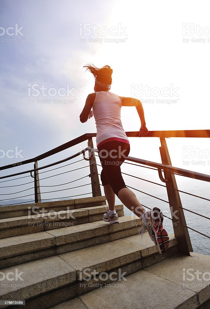 healthy lifestyle asian woman running at stone stairs seaside royalty-free stock photo