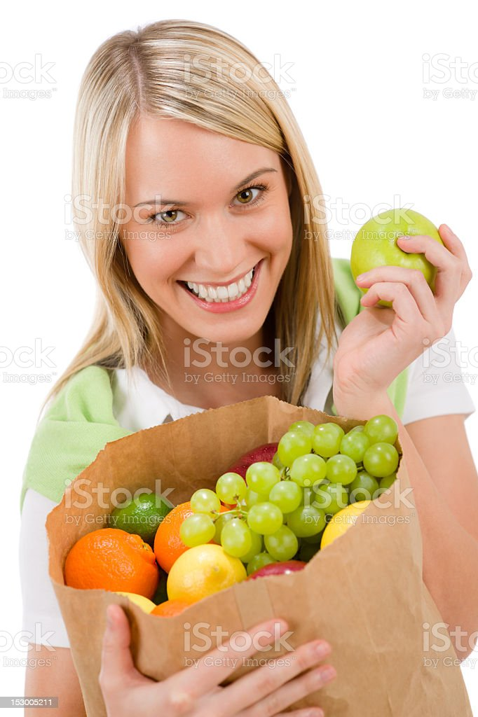 Healthy lifestyle - cheerful woman with fruit shopping bag royalty-free stock photo