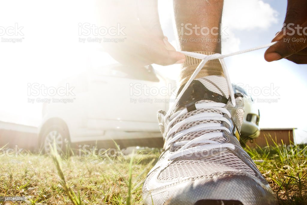 healthy lifestyle exercise routine; sneaker shoelace tied stock photo