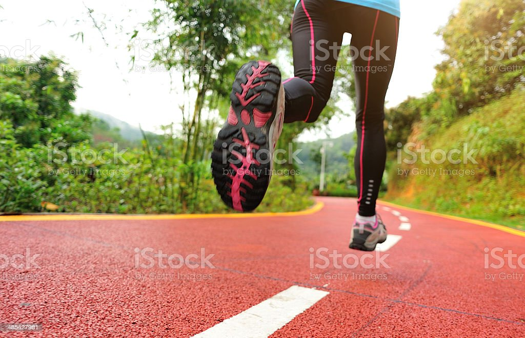 healthy lifestyle fitness sports woman legs running at park trail royalty-free stock photo