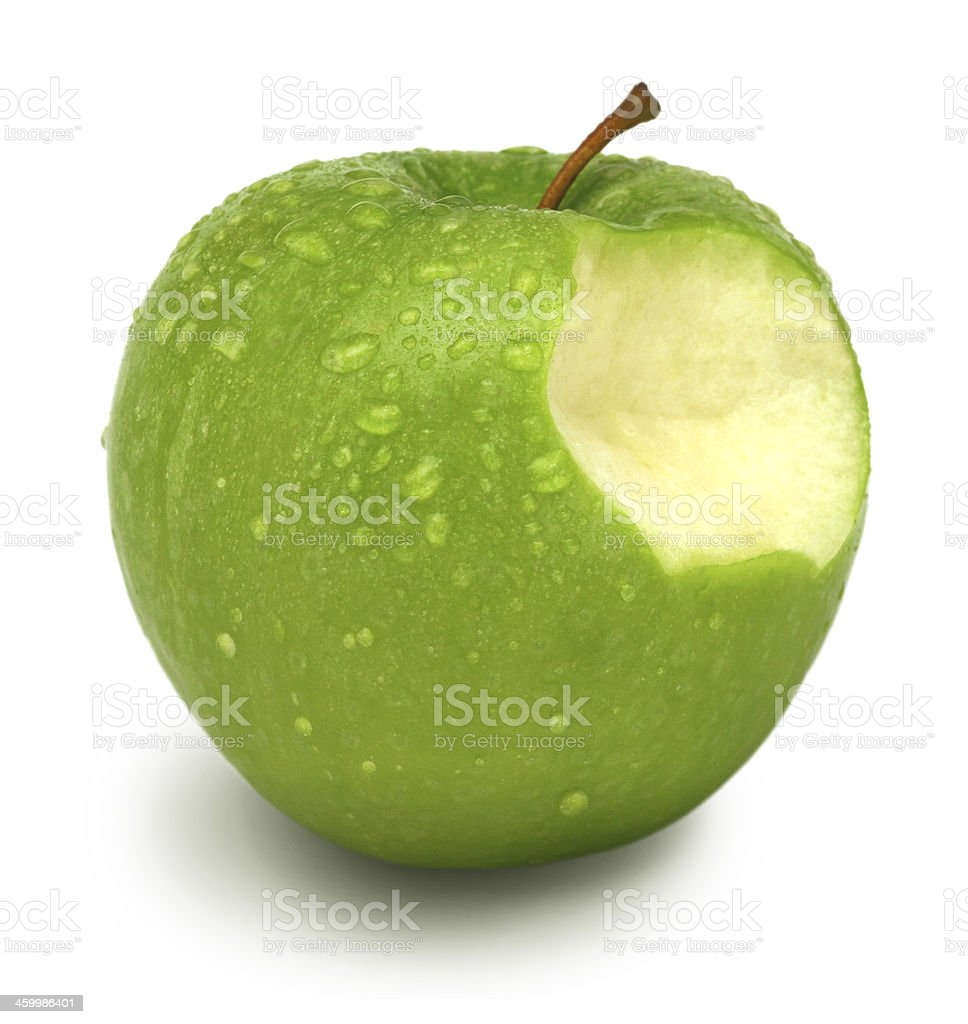 Healthy lifestyle - green apple with bite stock photo