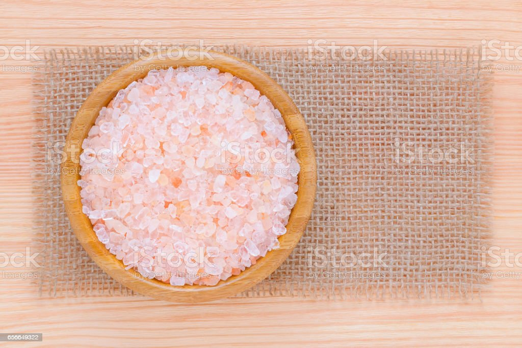 healthy lifestyle, pink himalayan salt in a wooden bowl stock photo