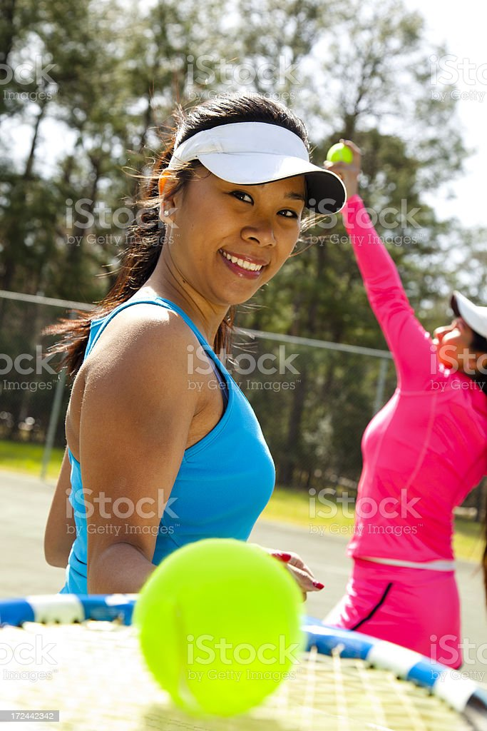 Healthy Lifestyle:  Two ladies on the tennis court. royalty-free stock photo