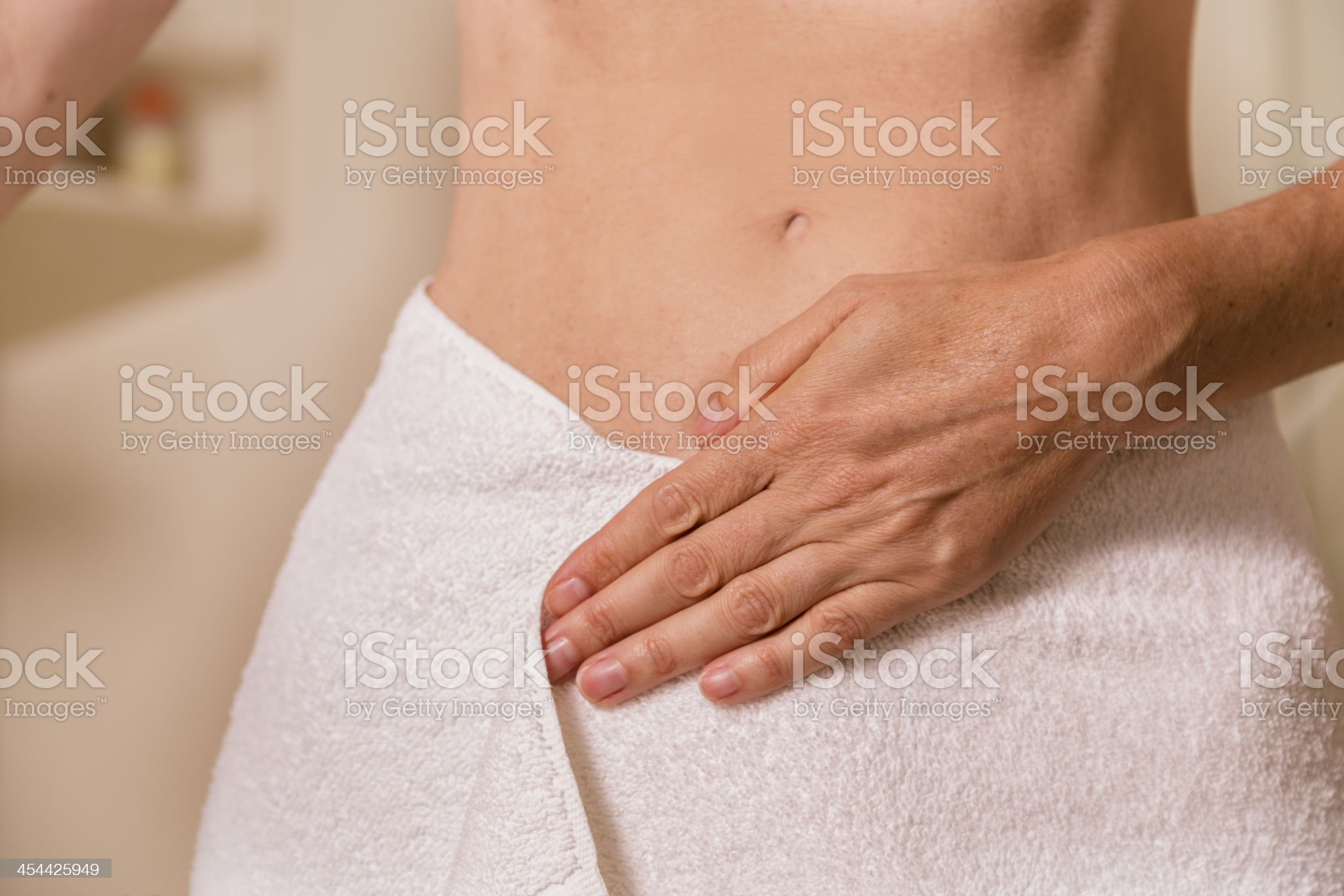 Healthy Lifestyle: Woman examining her body after a bath. royalty-free stock photo