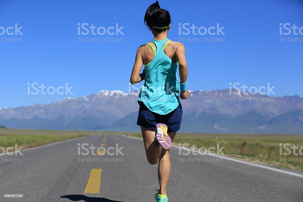 healthy lifestyle young fitness woman runner running on road stock photo