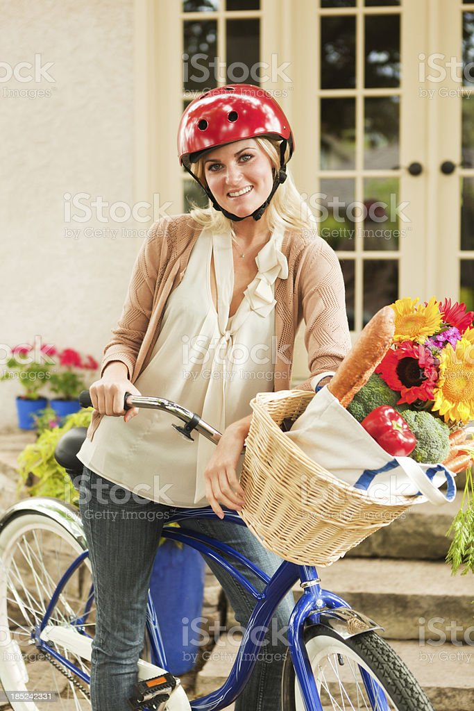 Healthy Lifestyle Young Woman Bicycling for Grocery Shopping Vt royalty-free stock photo