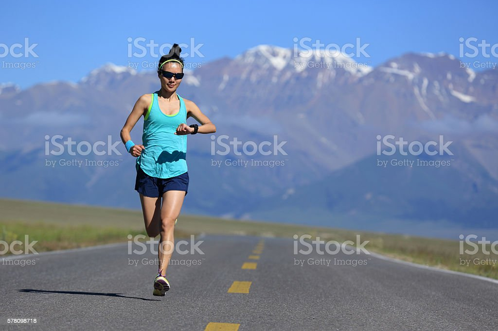 healthy lifestyle young woman runner running on trail stock photo