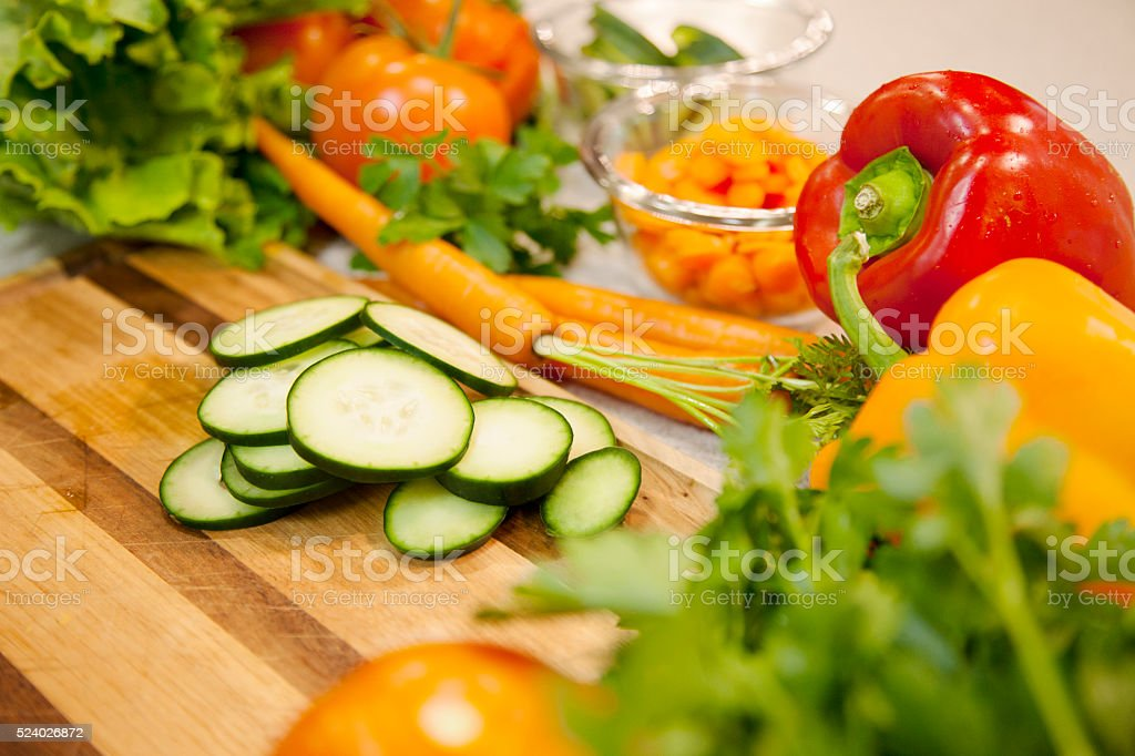 Healthy Lifestyles: Fresh, organic vegetables on wooden cutting board. stock photo