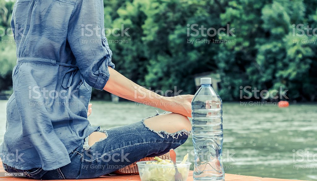 healthy living and relaxation beside the river stock photo