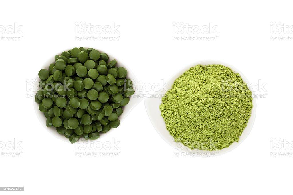 Healthy living. Spirulina pills and wheatgrass. royalty-free stock photo