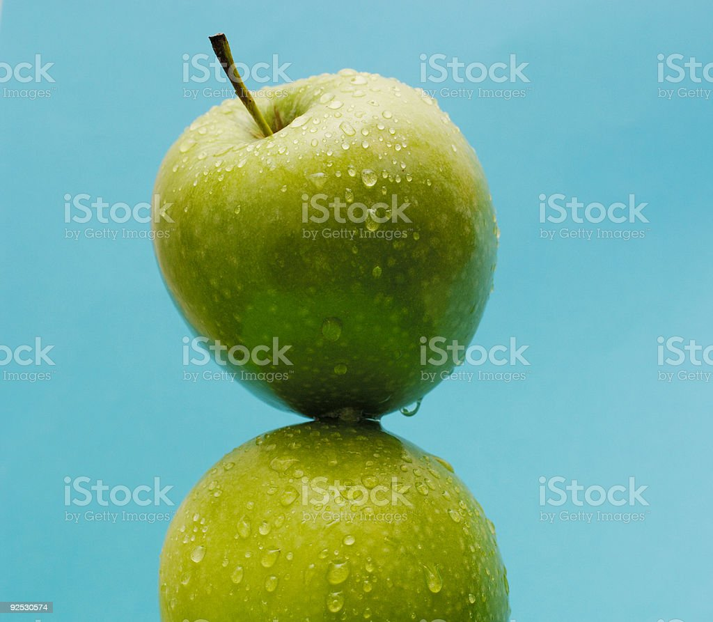 healthy living, water covered green apple against blue royalty-free stock photo