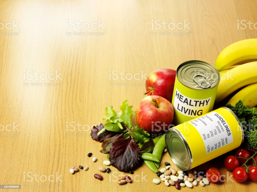 Healthy Living with Guidelines and Fresh Vegetables stock photo