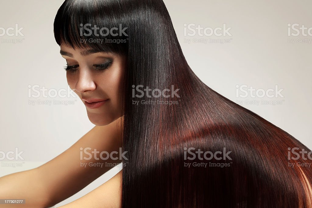 Healthy long brunette hair on a pretty woman royalty-free stock photo