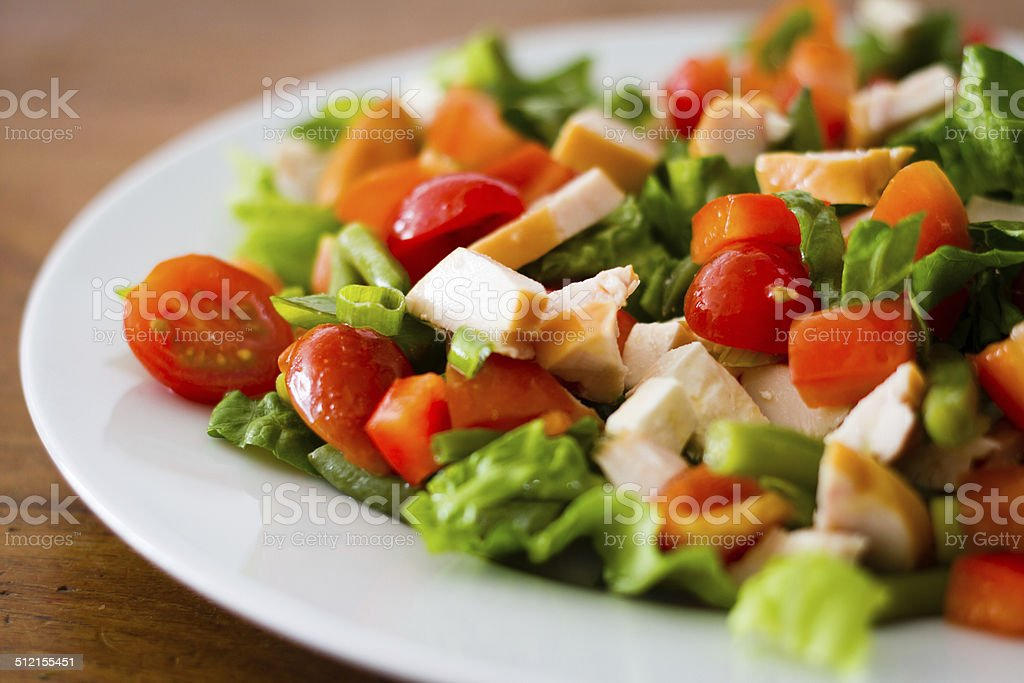 Healthy looking salad on a white plate stock photo