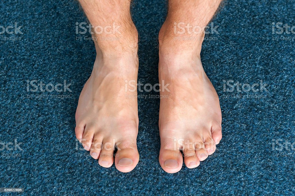 Healthy male feet feeling comfortable at home stock photo