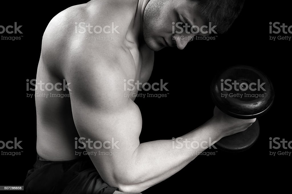 Healthy Man Exercising with Arm Weights stock photo
