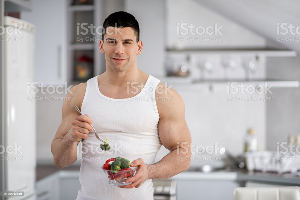 Healthy man in the kitchen stock photo