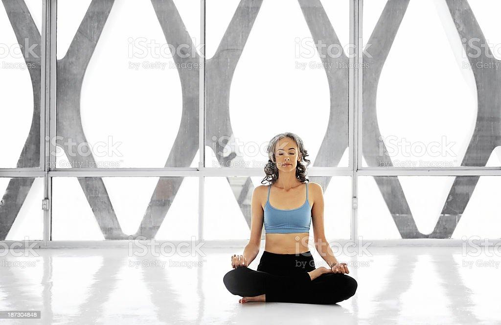 Healthy mature woman doing yoga stock photo