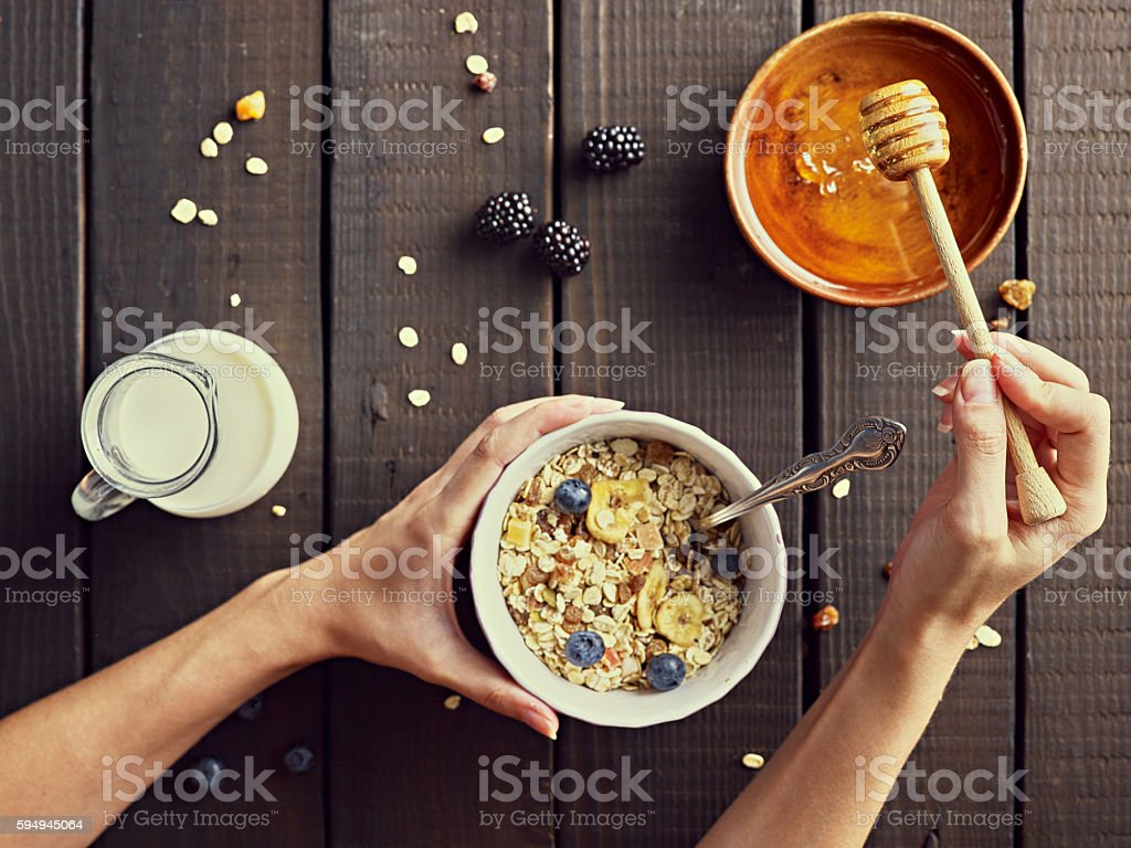 Healthy meal, cereals with milk and honey. stock photo