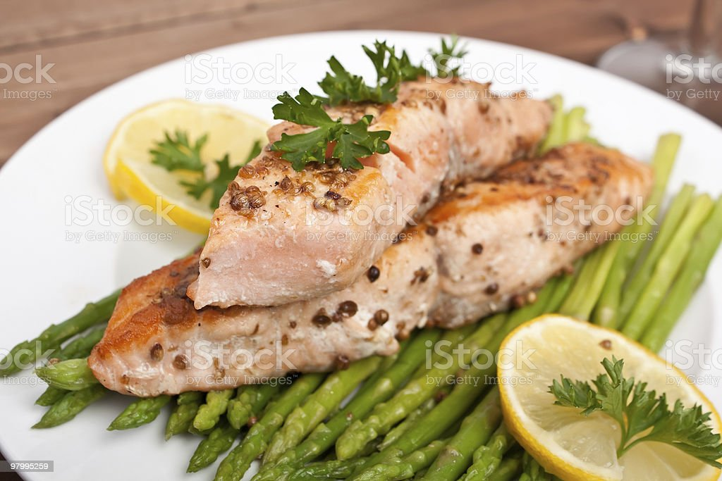 A healthy meal containing salmon and asparagus royalty-free stock photo