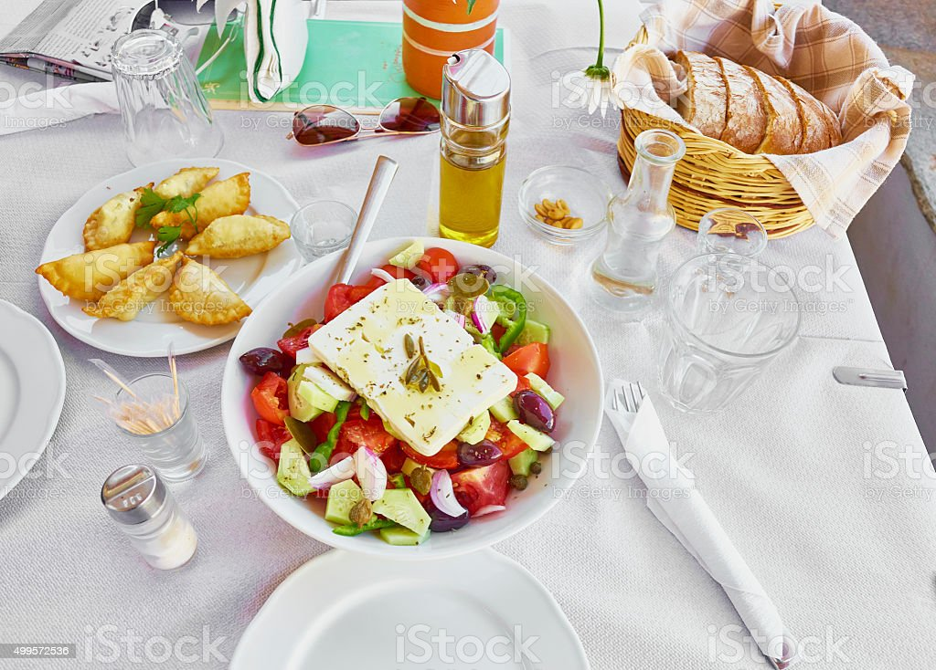 Healthy mediterranian meal with vegetables on table stock photo