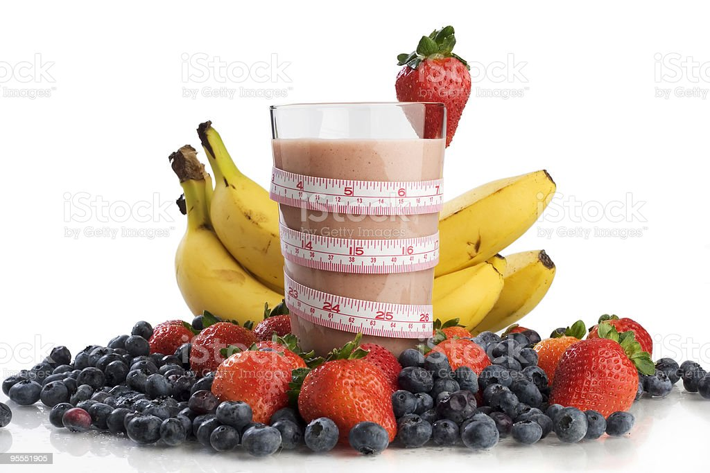 Healthy mixed fruit smoothie with measuring band royalty-free stock photo