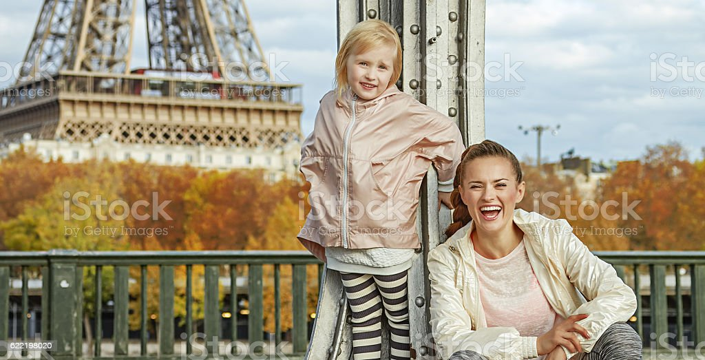 healthy mother and daughter on Pont de Bir-Hakeim bridge, Paris stock photo