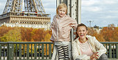 healthy mother and daughter on Pont de Bir-Hakeim bridge, Paris