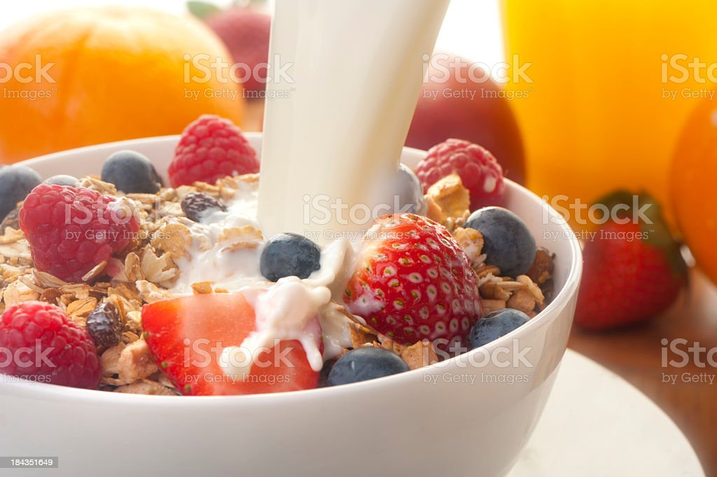 Healthy muesli breakfast with milk stock photo