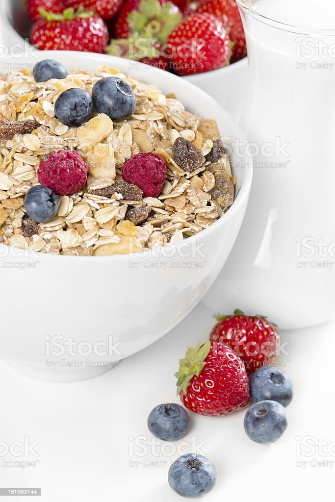Healthy muesli with fresh berries and milk royalty-free stock photo