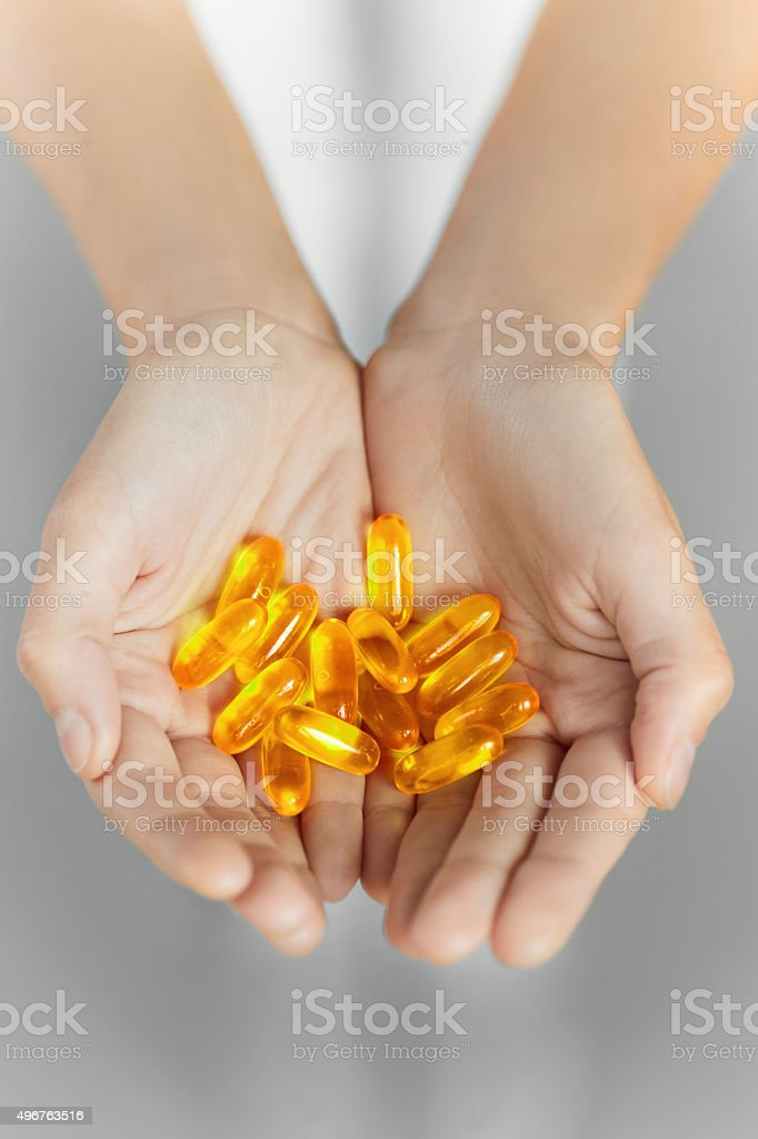 Healthy Nutrition. Cod Liver Oil Omega 3 Gel Capsules. Nutrition stock photo