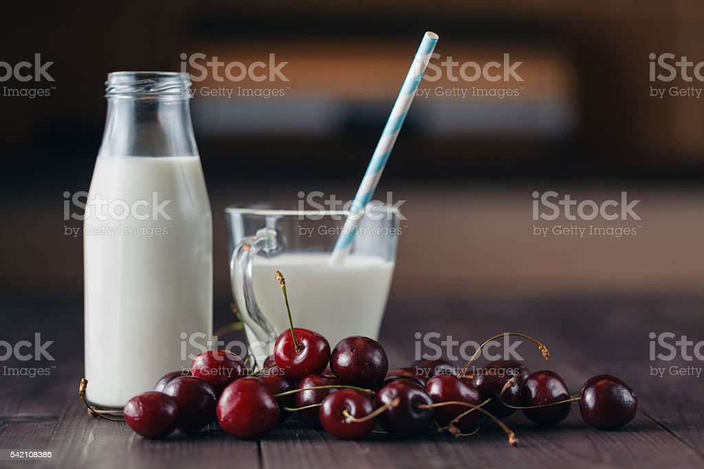 Healthy of breakfast of cherry,  glass of milk stock photo