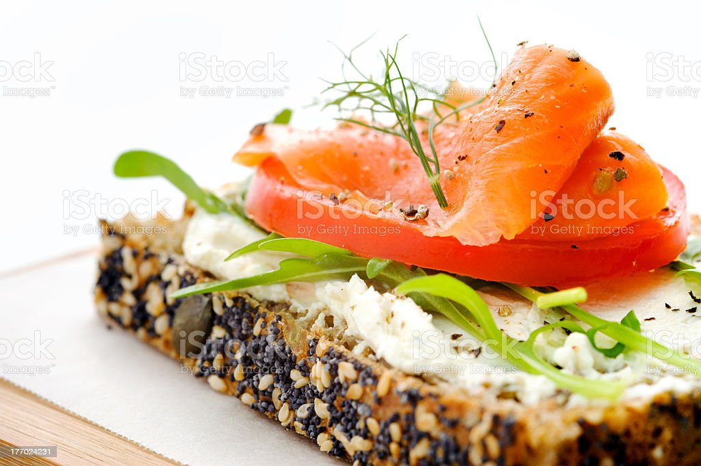 Healthy open sandwich with smoked salmon stock photo