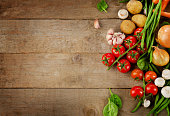 Healthy organic foods on wooden background.