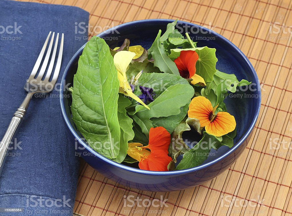 Healthy organic green salad with edible flowers stock photo