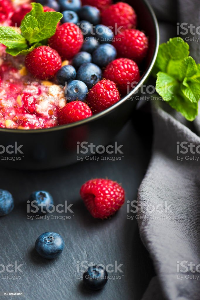 Healthy organic porridge topped with berries stock photo