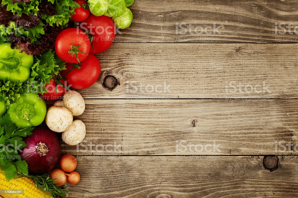 Healthy Organic Vegetables on a Wooden Background stock photo