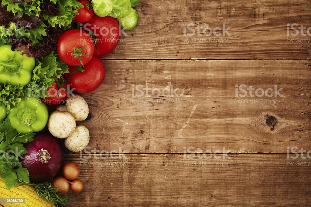 Healthy organic vegetables on brown wooden table stock photo