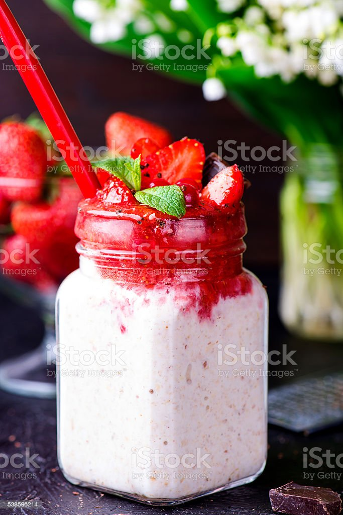 Healthy overnight oats with strawberry in jars stock photo
